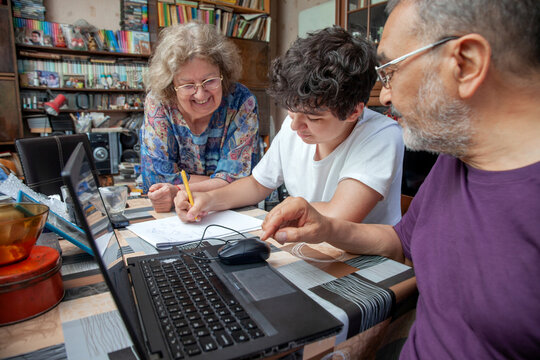 Teenage Boy is Taking Math Lessons From Grandparents at Home