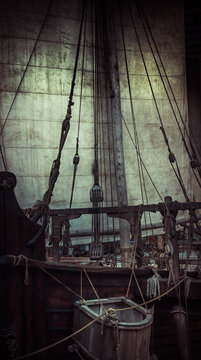Old pirate ship with sail and mast as gloomy vintage retro background