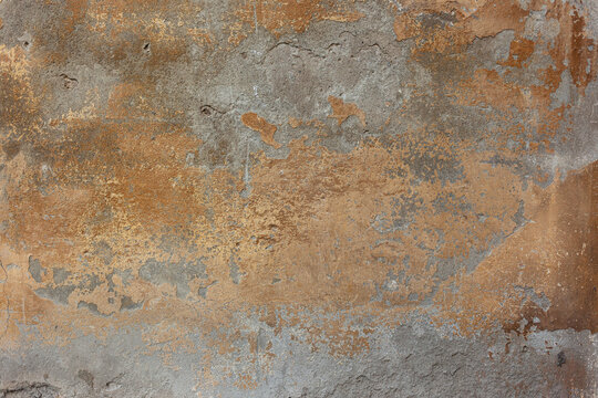 old concrete wall with bronze paint stains