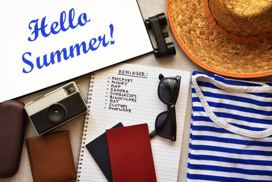 Hello Summer text with accessories and checklist of a traveler. Retro style photo. Top view.
