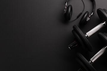 Fototapeta Headphones and dumbbells. Sport, fitness and healthy lifestyle obraz