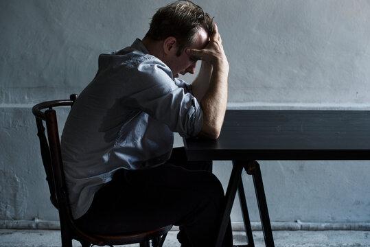 Depressed man showing depressed expression