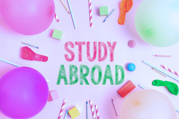 Text sign showing Study Abroad. Business approach Pursuing educational opportunities in a foreign...