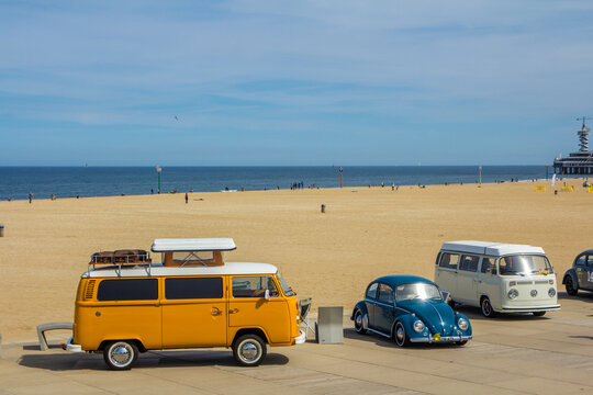 Scheveningen beach, the Netherlands - May 21, 2017: orange VW combi camper wagens and beetle at Aircooled classic car show