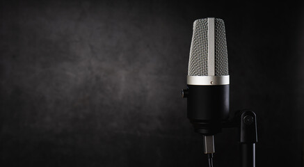 microphone for audio record or Podcast concept, single microphone on dark shadow background  with...