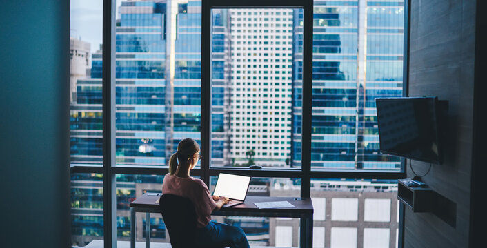 Woman working on laptop during workday
