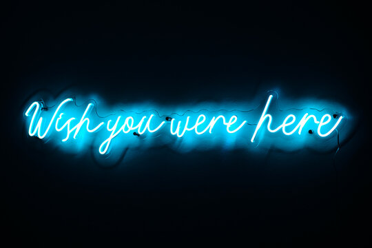 neon sign 'wish you were here'