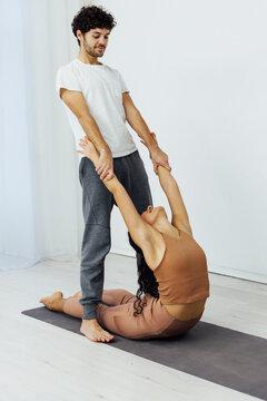 Man and woman paired family yoga asana gymnastics fitness