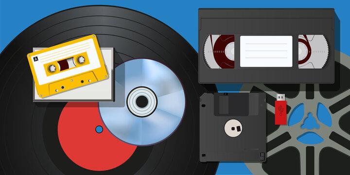Concept du vintage, avec une collection de matériels d'enregistrement vidéo et audio, tel que cassettes, disque vinyle, clé USB et bobine de film.