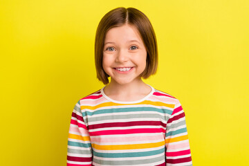 Photo portrait little girl in striped clothes smiling isolated bright yellow color background Wall mural