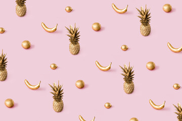 Golden sunlight summer pattern made with tropical summer fruits on pastel pink background. Trendy abstact creative concept.