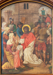 VIENNA, AUSTIRA - JUNI 17, 2021: The painting fresco Jesus meets the women of Jerusalem as part of Cross way stations in church Marienkirche by redemptorist Maximilian Schmalzl from end of 19. cent.