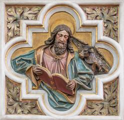 VIENNA, AUSTIRA - JUNI 24, 2021: The relief of St. Luke the Evangelist in church St. Severin.