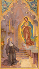 VIENNA, AUSTIRA - JUNI 24, 2021: The fresco of traditional Divine Mercy of Jesus in the Votivkirche church by brothers Carl and Franz Jobst (sc. half of 19. cent.).