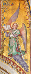 VIENNA, AUSTIRA - JUNI 24, 2021: The fresco of angel with the book in the Votivkirche church by brothers Carl and Franz Jobst (sc. half of 19. cent.).