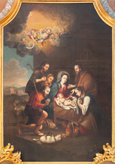 VIENNA, AUSTIRA - JUNI 24, 2021: The painting of Adoration of Shephedrs in the church Pavlanerkirche by unknown artist.