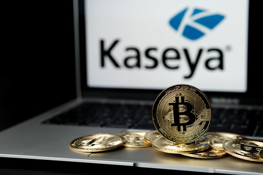Bitcoins and blurred Kaseya company logo on the screen of laptop. Concept for ransomware attack and security breach.  Stafford, United Kingdom, July 6, 2021.
