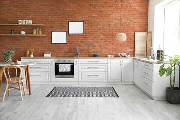 Fototapeta Interior of modern kitchen with blank photo frames obraz