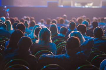 Fototapeta Unrecognizable people sitting in dark auditorium obraz