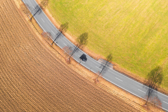 a lone car on a countryside street from above