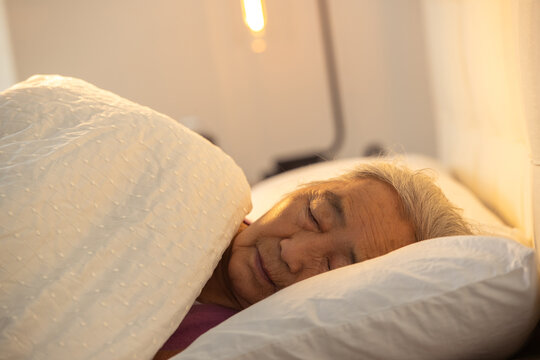 Lonely old woman sleeping