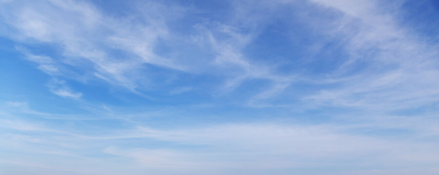 Blue sky with white cirrus clouds on a daytime, background