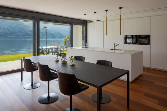 Interior of a modern apartment, kitchen and dining room stand together. High standing, nobody inside.