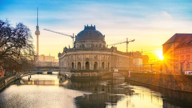 Museum Island on Spree river and TV tower in the background at sunrise, Berlin, Germany