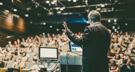 Obraz Public speaker giving talk at Business Event. - fototapety do salonu