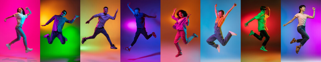 Fototapeta Portrait of group of people jumping isolated on multicolored background in neon light, collage. obraz