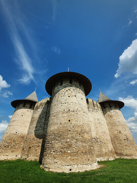Soroca Fortress view from outside. Ancient military fort, historical landmark located in Moldova. Outdoors facade, old stone walls fortifications, towers and bastions of medieval citadel