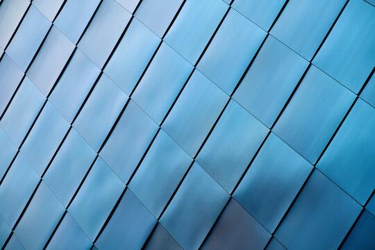 Fassadenverkleidung aus blauem Edelstahl an einem modernen Industriegebäude in Magdeburg