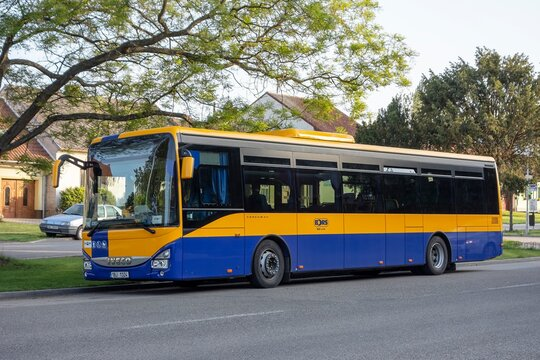 The blue-yellow Iveco Crossway LE Line 12M coach of Bors company in Southern Moravia