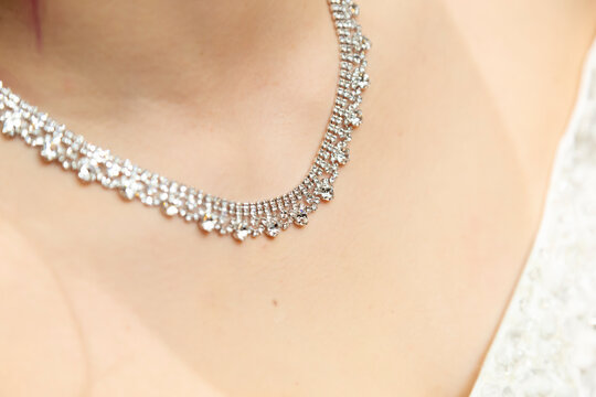 Necklace on the chest of the bride heading to the wedding