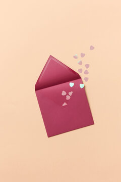 Pink envelope with paper hearts
