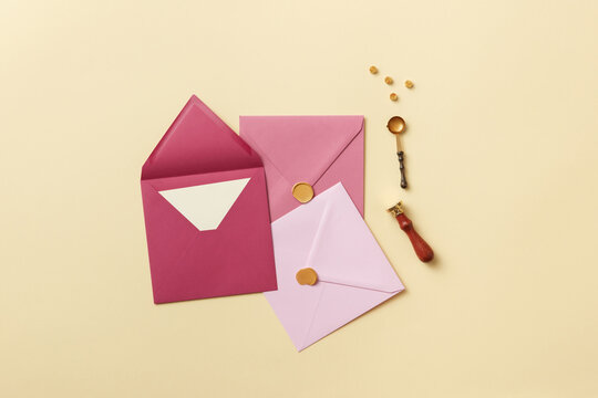 Pink envelopes for love letters and handle stamp
