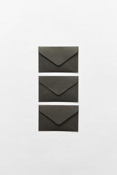 Three black envelopes
