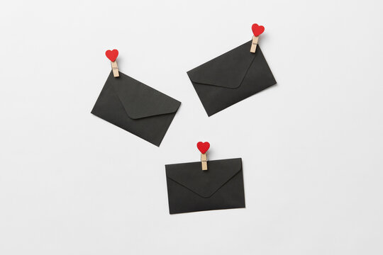 Black envelopes with red hearts