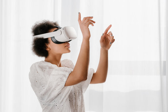 Black female in VR glasses interacting with cyberspace
