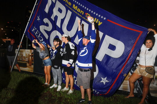 Fans celebrate after the Tampa Bay Lightning ice hockey team won the NHL Stanley Cup Finals over the Montreal Canadiens, in Tampa