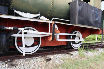 Old large iron train wheels, antique train or ancient railway, bogies are on the tracks for an industrial steam locomotive.