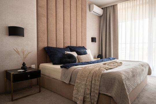 Fancy beige bedroom with dark details