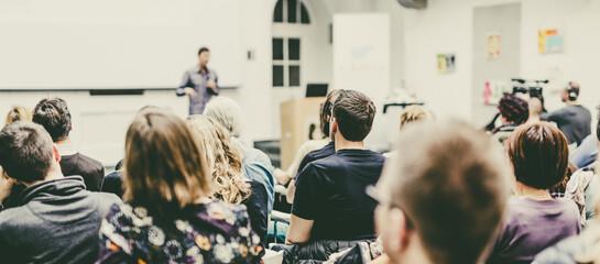 Fototapeta Man giving presentation in lecture hall at university. obraz