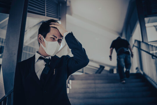 Asian man business in city of thailand,Handsome man wearing protection medical mask covid-19 or coronavirus from Infected person,corona protected Help protect For world and people stop virus warning