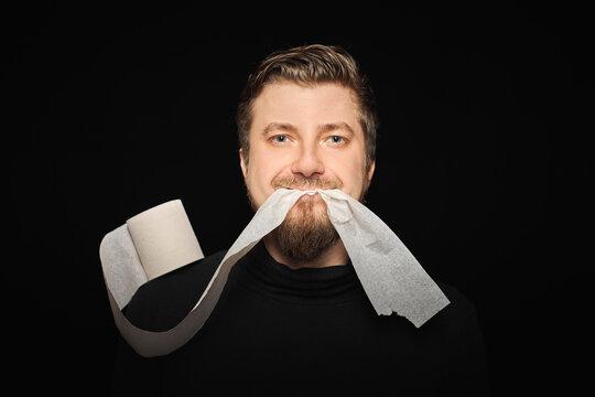 Man eating toilet paper. Hunger strike
