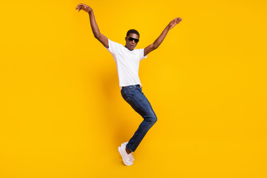 Full length body size view of attractive funky carefree guy dancing having fun good mood isolated over bright yellow color background