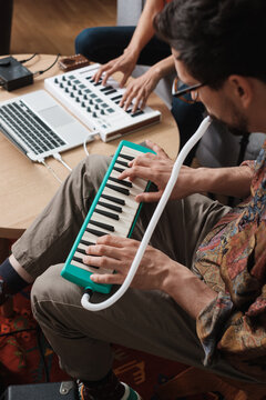 Band Member Playing Melodica