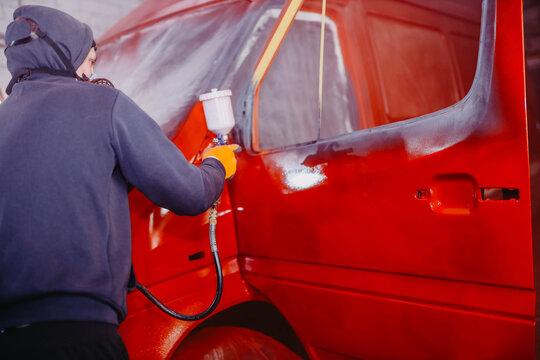 car painting in red, truck body repair.