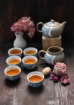 Still life with a tea set over dark background