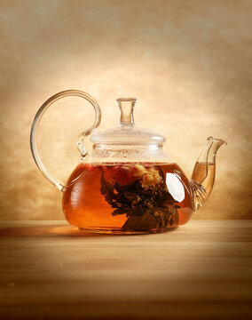 Glass tea pot on the table indoors